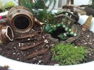Repurposing old knick-knacks can add a quaint touch to your fairy garden.